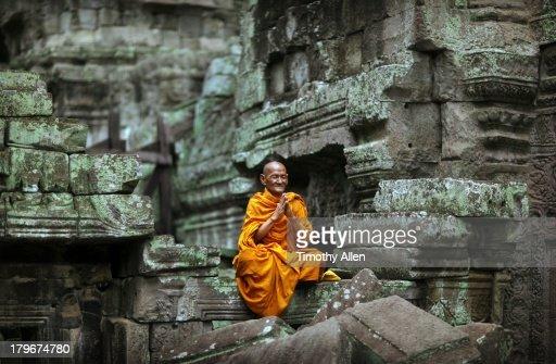 Buddhist monk meditating in temple