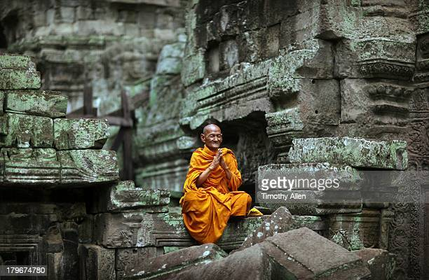 Buddhist monk meditating in temple