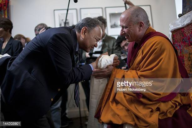 Buddhist monk Nicky Vreeland the grandson of legendary fashion editor Diana Vreeland offers a silk scarf to a well wisher after he speaks to a crowd...