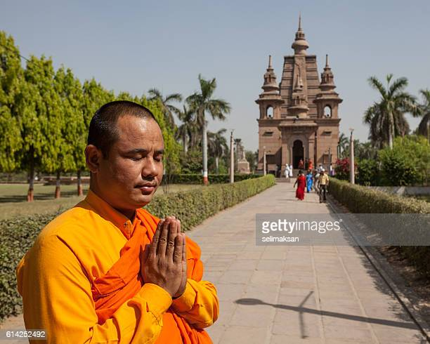 Buddhist Monk Praying In Sarnath, Mulagandhakuti Vihara