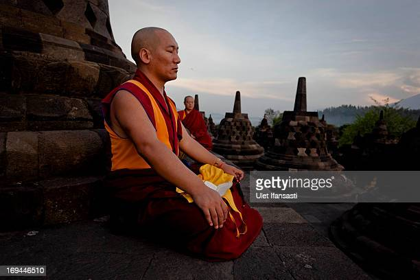 Buddhist monk prays at Borobudur temple during celebrations for Vesak Day on May 25 2013 in Magelang Central Java Indonesia Vesak is observed during...