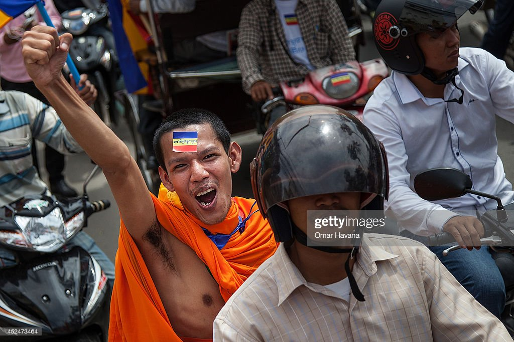 A Buddhist monk shouts slogans during a demonstration though the city streets to demand the return of the Kampuchea Krom territories to Cambodia on July 21, 2014 in Phnom Penh, Cambodia. Thousands of protesters and monks march through the streets of Phnom Penh to deliver petitions to the French, British, American, Russian and Chinese embassies, before arriving at the Vietnamese Embassy. The protesters, organised by the Federation of Cambodian Intellectuals and Students (FCIS) and leaders of the Khmer Krom community, are demanding an apology from Vietnamese Embassy First Counsellor Tran Van Thong, who recently said that the former Kampuchea Krom provinces were held by Vietnam before their occupation by France. Ahead of the protest, Phnom Penh municipal authorities banned the protest, threatening the protesters who defied the ban could be jailed for up to 15 years.