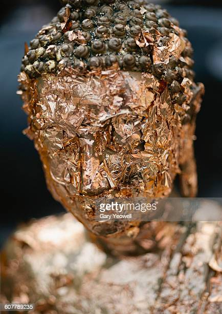 Buddhist Monk statue covered in gold leaf