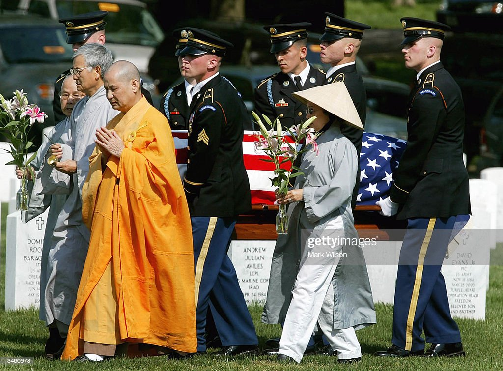 Buddhist Monk, Thich Kien Khai leads an honor guard procession carrying the casket of US Army Sgt. Yihiyh Chen during a funeral at Arlington National Cemetery April 23, 2004 in Arlington, Virginia. Chen was killed on April 4th in Baghdad, Iraq when his unit was attacked with rocket propelled grenades and small arms fire.