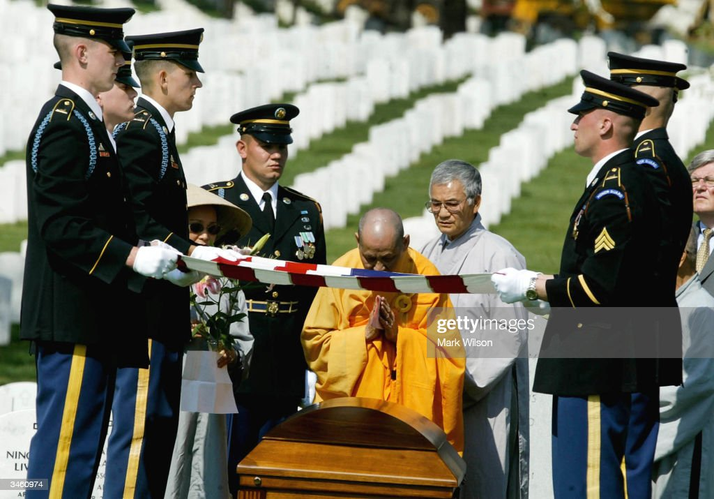Buddhist Monk, Thich Kien Khai prays in front of the casket of US Army Sgt. Yihiyh Chen during a funeral at Arlington National Cemetery April 23, 2004 in Arlington, Virginia. Chen was killed on April 4th in Baghdad, Iraq when his unit was attacked with rocket propelled grenades and small arms fire.