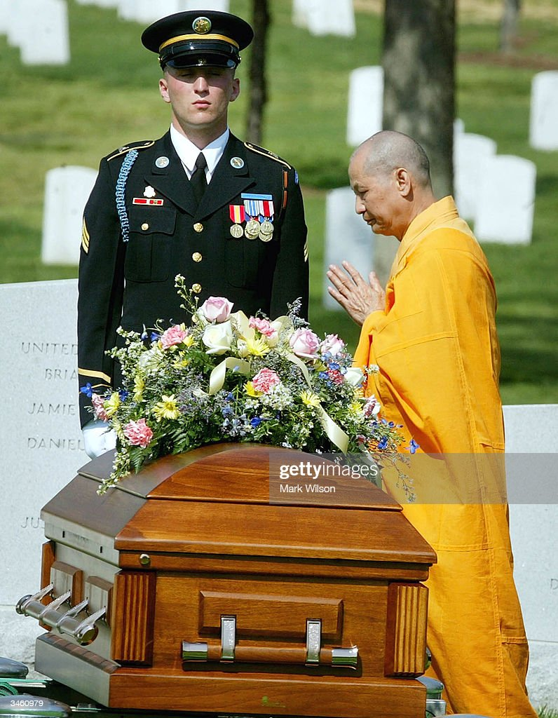 Buddhist Monk, Thich Kien Khai stands near the casket of US Army Sgt. Yihiyh Chen during a funeral at Arlington National Cemetery April 23, 2004 in Arlington, Virginia. Chen was killed on April 4th in Baghdad, Iraq when his unit was attacked with rocket propelled grenades and small arms fire.