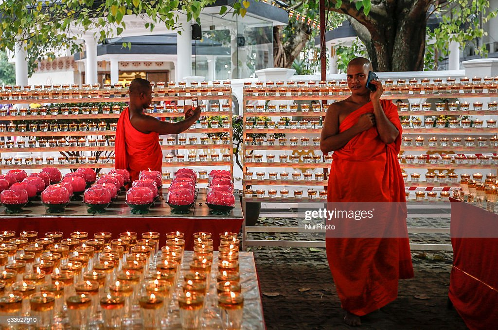 Buddhist monk uses mobile phone during the Vesak Day celebration in Kuala Lumpur on May 21 2016