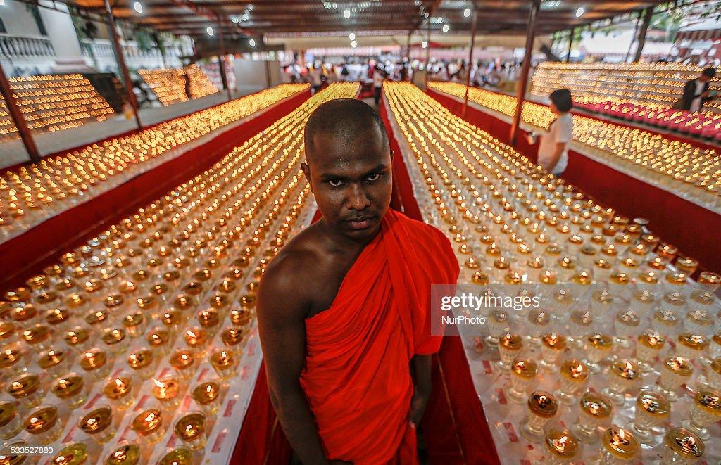 Buddhist monk Ven Dewagiriye Chandissara thero posing for pictures during the Vesak Day celebration in Kuala Lumpur on May 21 2016