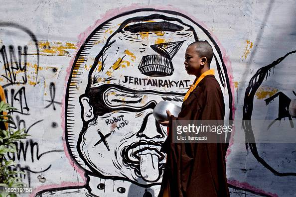 Buddhist monk walk around the streets to receive religious alms from Buddhist members during Pindapata procession on May 23 2013 in Magelang Central...