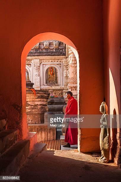 BODHGAYA BIHAR INDIA BODHGAYA BIHAR INDIA Buddhist monk walking around and praying at the Mahabodhi Mahavihara temple in Bodh Gaya Bihar India The...