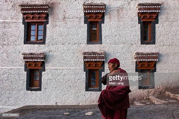 Buddhist monk walking down the way from Hemis gompa in Ladakh Jammu and Kashmir India
