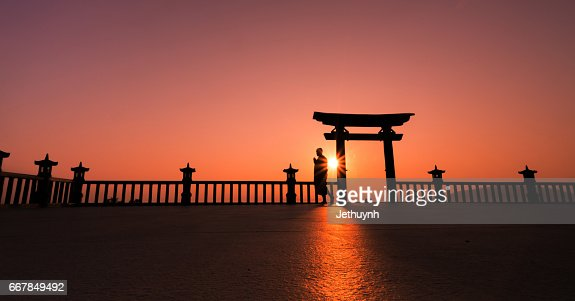 Buddhist monk walking for praying at gate of temple in a mountain in the morning  Stock Photo