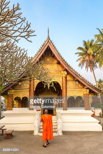 Buddhist monk walking to a temple, Laos