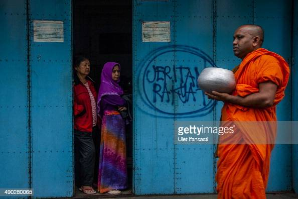 Buddhist monk walks around the streets to receive religious alms from Buddhist followers as they walk around the streets during Pindapata procession...