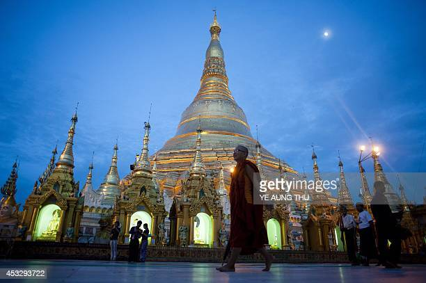 A Buddhist monk walks at the shwedagon pagoda in Yangon on August 7 2014 Myanmar faces being called to account for stalling reforms when it hosts a...