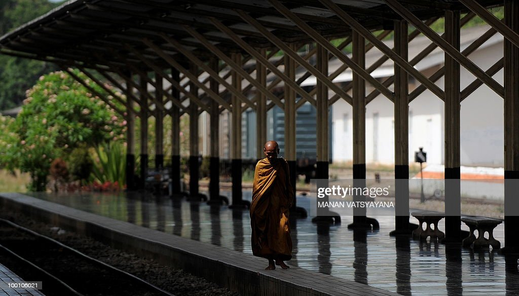 A Buddhist monk walks on the platform before the arrival of a train carrying Red Shirts protesters from Bangkok at the train station in Chiang Mai around 700kms from Bangkok on May 21, 2010. Thailand picked up the pieces after violence and mayhem triggered by a crackdown on anti-government protests, as the focus swung to recovery and reconciliation in a divided nation.