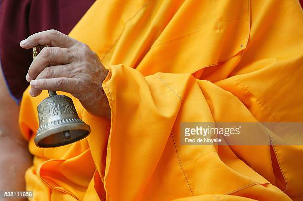 Buddhist Monk with Bell at Ceremony