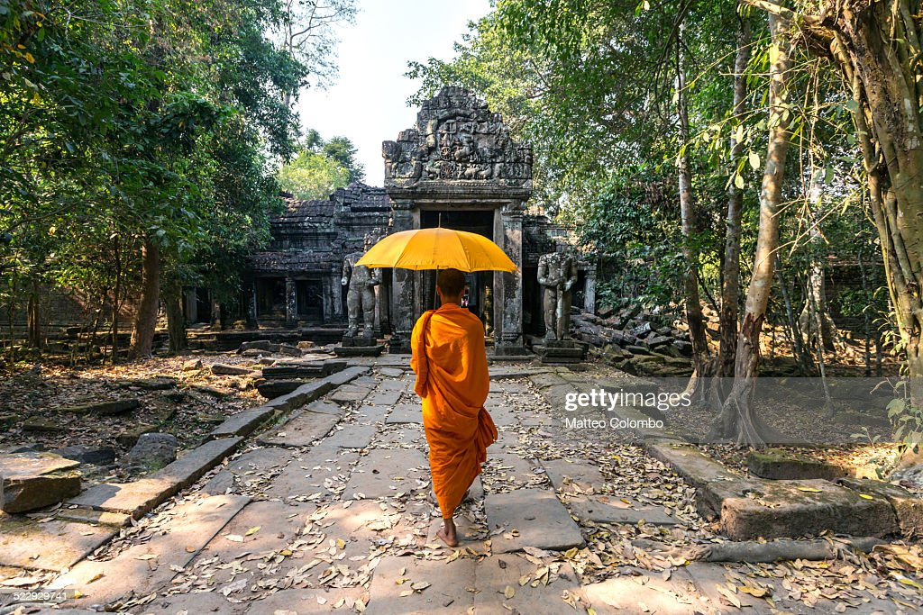Buddhist monk with umbrella, Angkor Wat, Cambodia : Stock Photo