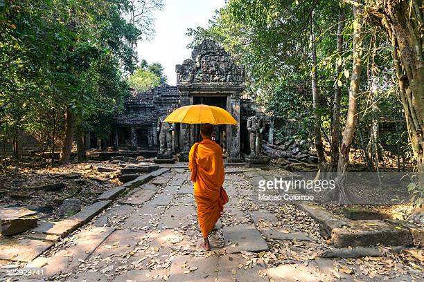 Buddhist monk with umbrella, Angkor Wat, Cambodia