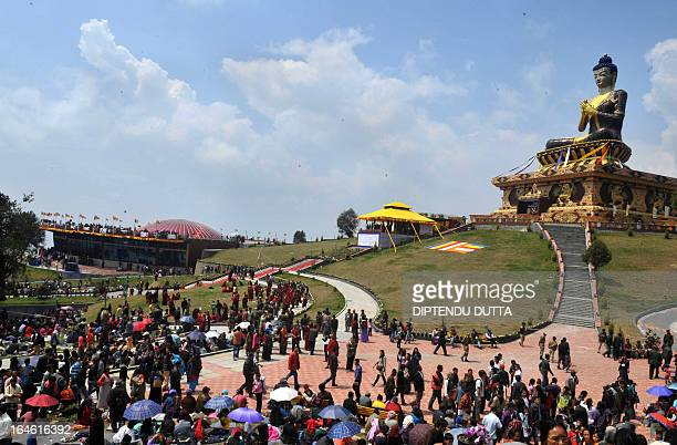 Buddhist monks and devotees gather during the inauguration of the 130 foot Lord Buddha statue by Tibetan spiritual leader the Dalai Lama at Buddha...