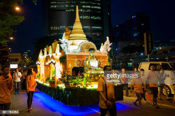 Buddhist monks and devotees take part in parade during Vesak day celebration in Kuala Lumpur Malaysia on May 10 2017 Vesak day on the fullmoon day of...