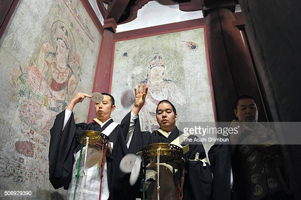 Buddhist monks and fire fighters attend a ceremony at the Kondo hall where the 1300yearold murals are damaged by fire in a 1949 at Horyuji Temple on...