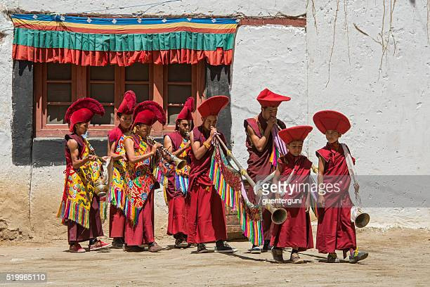 Buddhist monks are playing music during festival in Ladakh.
