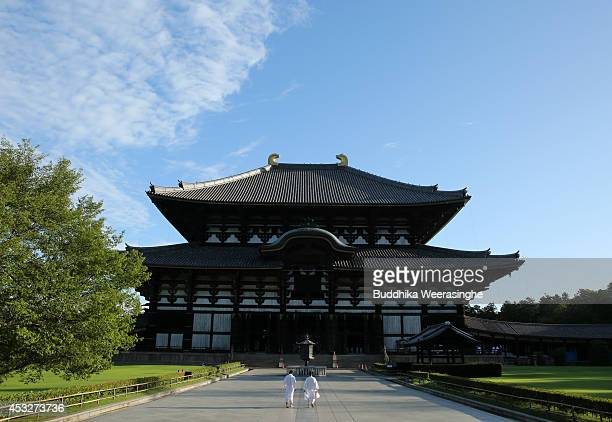 Buddhist monks arrive to clean the dust off of the 15meterhigh Great Buddha at the Todaiji Temple on August 7 2014 in Nara Japan About 100 Buddhist...