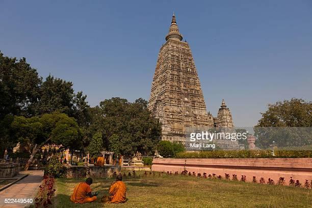 BODHGAYA BIHAR INDIA BODHGAYA BIHAR INDIA Buddhist monks at the Mahabodhi temple in Bodh Gaya Bihar India 'Great Awakening Temple' is a Buddhist...
