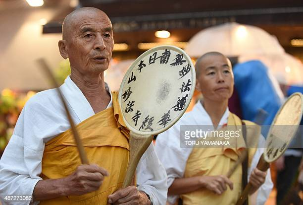 Buddhist monks chant prayers during an antigovernment rally in Tokyo on September 8 against Japan's Prime Minister Shinzo Abe's controversial...