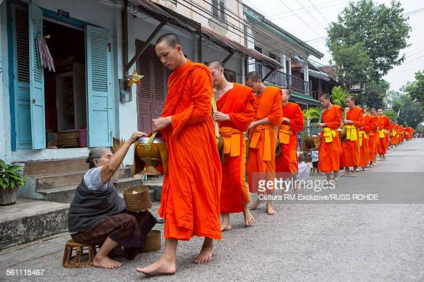 Buddhist monks collecting Alms at dawn, Luang Prabang, Laos
