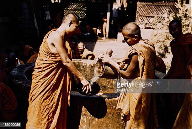 Buddhist monks collecting water from a well Myanmar circa 1950 Original publication Picture Post 4748 Inside The Temples Of Burma pub 21st January...