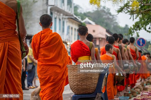 Buddhist monks daily ritual of collecting alms and offerings