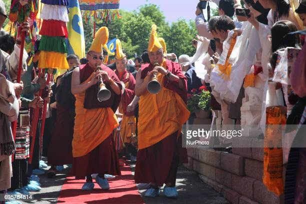 Buddhist monks dressed in ceremonial attire welcome His Holiness the 17th Gyalwang Karmapa Ogyen Trinley Dorje during his visit to the Karma Tekchen...