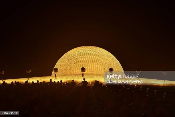 TOPSHOT Buddhist monks find a place to sit before morning prayers to mark Makha Bucha Day at Wat Dhammakaya temple just north of Bangkok on February...