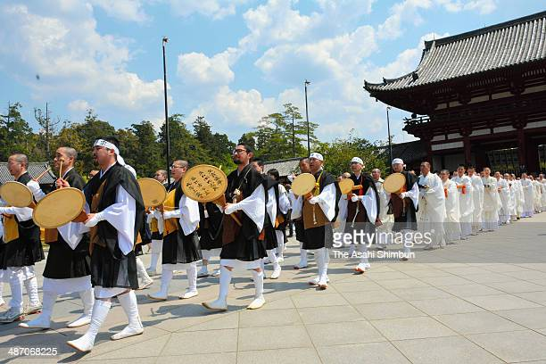 Buddhist monks from different sects march on together from Nandaimon Gate at Todaiji Temple on April 26 2014 in Nara Japan