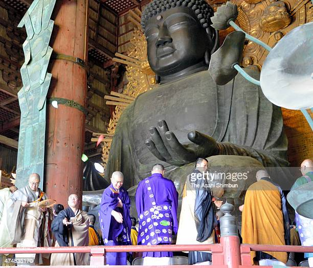 Buddhist monks from different sects pray for the world peace in front of the Great Buddha at Todaiji Temple on May 26 2015 in Nara Japan