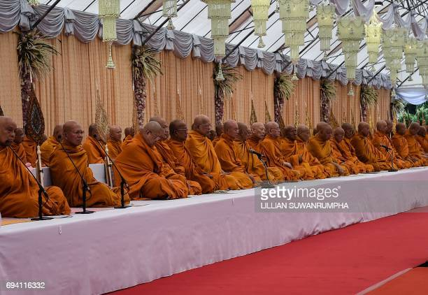 Buddhist monks gather during a ceremony in honour of the late Thai King Bhumibol Adulyadej at the King Rama V Monument in Bangkok on June 9 2017 /...