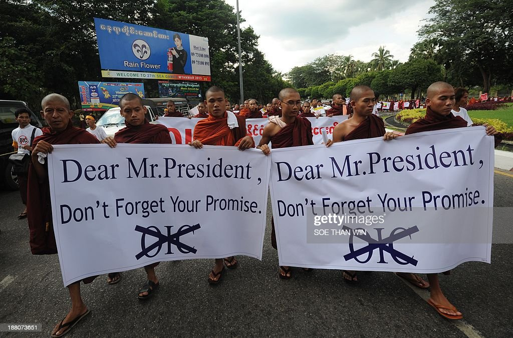 Buddhist monks holding banners attend a demonstration against a visit by members of the Organisation of Islamic Cooperation (OIC), in Yangon on November 15, 2013. Myanmar Buddhist monks led rallies against the Organisation of Islamic Cooperation as delegates from the Muslim body toured western Rakhine state, where religious violence has torn communities asunder. The delegation from the world's top Islamic body is in the country to discuss the response to several bouts of anti-Muslim violence that have left some 250 people dead and tens of thousands homeless.