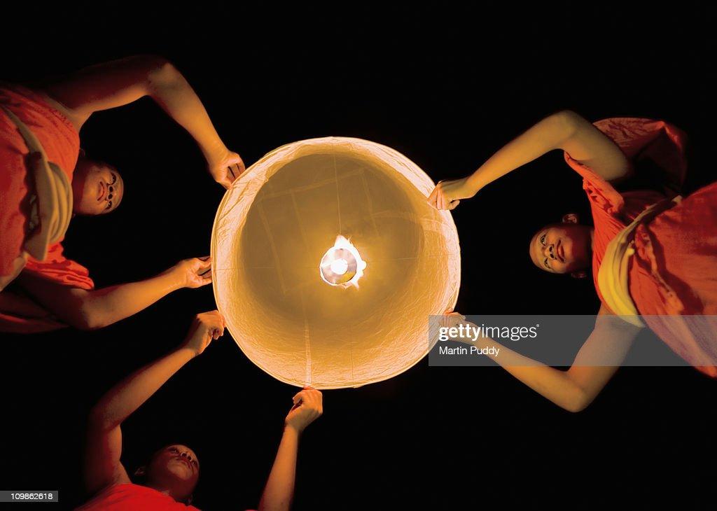 Buddhist Monks Launching a Khom Loy Lantern : Stock Photo