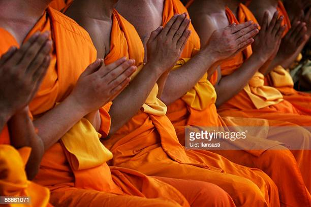 Buddhist monks meditate at Mendut Temple on Vesak Day commonly known as 'Buddha's birthday' at the Borobudur Mahayana Buddhist monument on May 09...