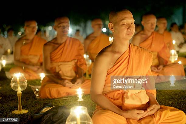 Buddhist monks meditate at the yard of Borobudur temple built between 750 and 842 AD June 1 2007 in Magelang Central Java province Indonesia...