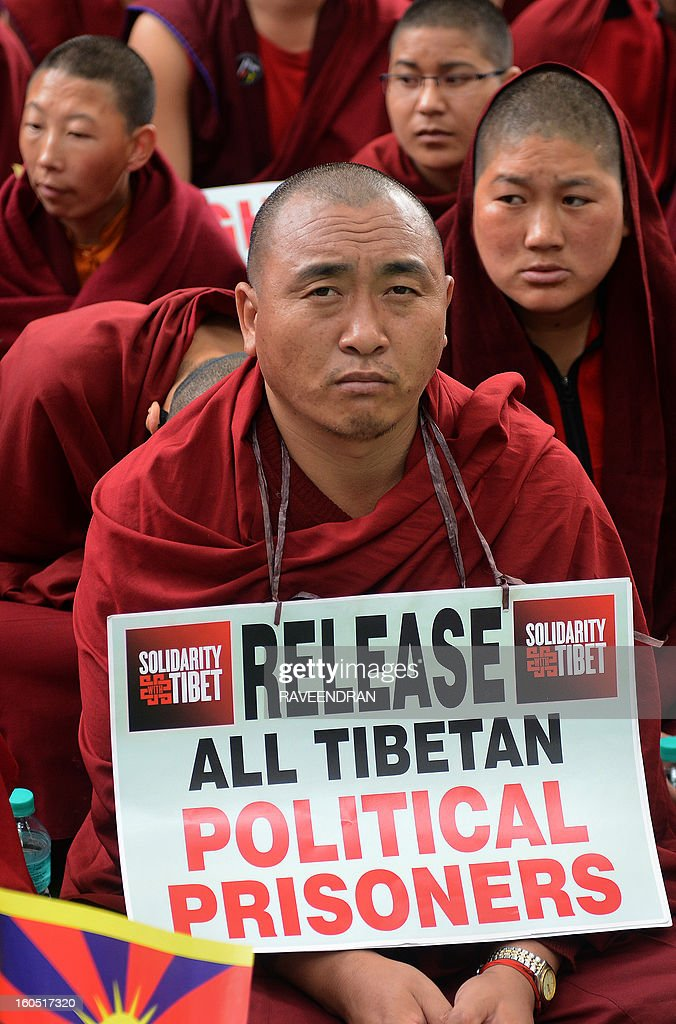 Buddhist monks, nuns and activists attend a protest rally in New Delhi on February 2, 2013. The Tibetan government in exile launched a Solidarity with Tibet Campaign 2013, as Tibetans continue to self-immolate calling for freedom in Tibet.