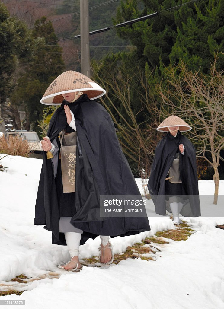 Buddhist monks of Hosshinji Temple walk in the snow with ringing the bell during the Takuhatsu alms on January 6 2015 in Obama Fukui Japan The...
