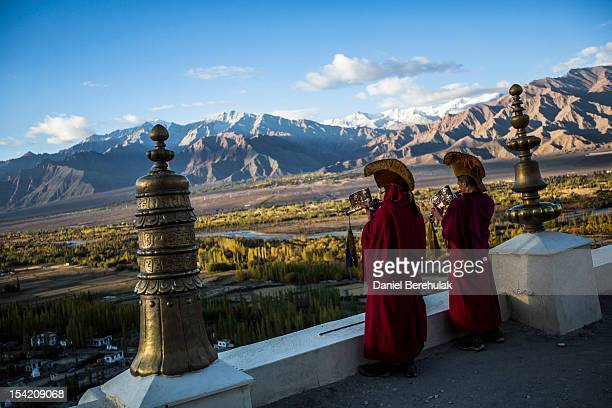 Buddhist monks play Tibetan trumpets prior to morning prayers at the Thikse Monastery on October 5 2012 near Leh in Ladakh India The Thikse monastery...