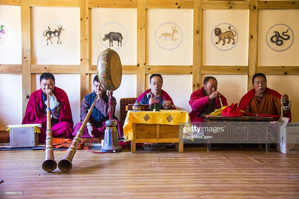 Buddhist monks playing long horns and percussion symbols on November 18, 2012 in Bumthang, Bhutan.