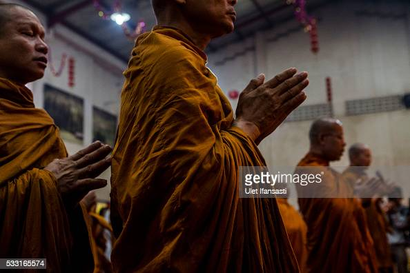 Buddhist monks pray at a temple as they prepare before a walk around the streets to receive religious alms from Buddhist followers during Pindapata...