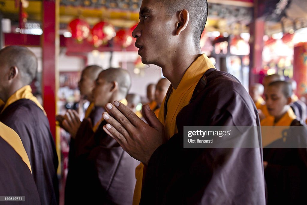 Buddhist monks pray at the temple after walking around the streets to receive religious alms from Buddhist during Pindapata procession on May 23, 2013 in Magelang, Central Java, Indonesia. As many as 100 monks took to the streets of Magelang city in a procession known as Pindapata, ahead of Vesak day which celebrates the birth of the Lord Buddha.