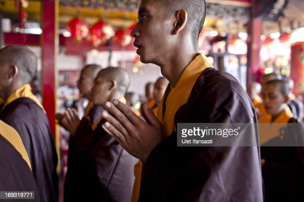 Buddhist monks pray at the temple after walking around the streets to receive religious alms from Buddhist during Pindapata procession on May 23 2013...