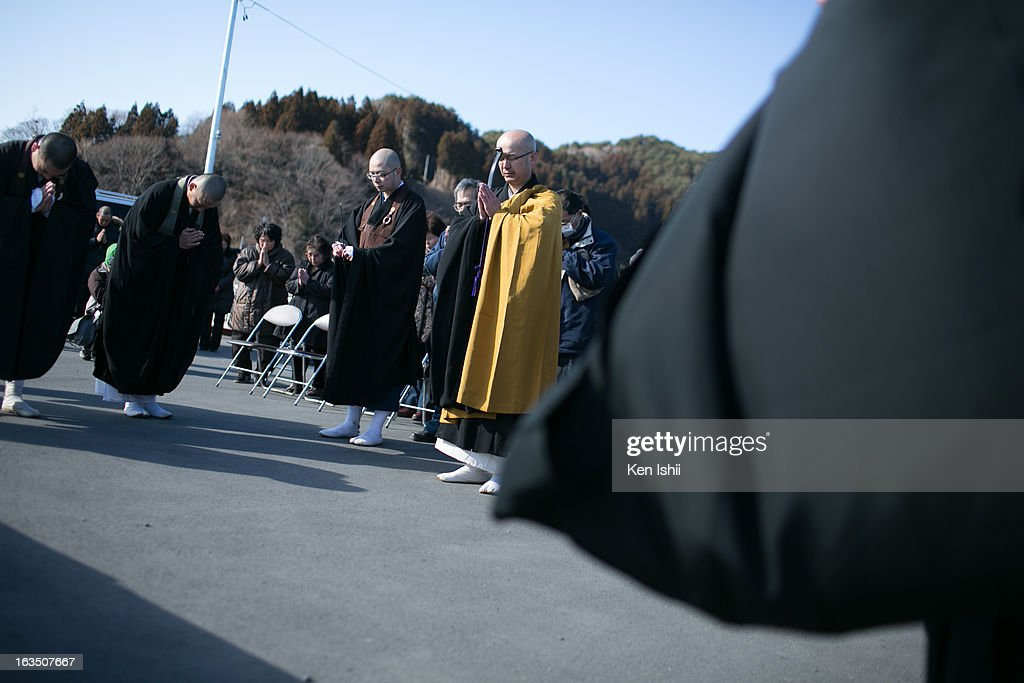 Buddhist monks pray toward the sea in silence on March 11, 2013 in Ootsuti, Iwate prefecture, Japan. On March 11 Japan commemorates the second anniversary of the magnitude 9.0 earthquake and tsunami that claimed more than 18,000 lives.